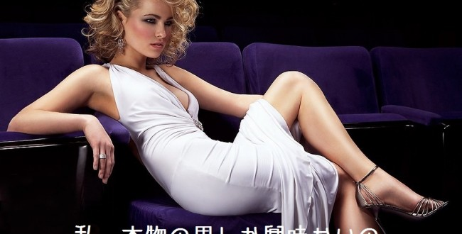5625-a-beautiful-woman-in-a-white-dress-sitting-on-theatre-chairs-pv
